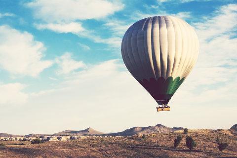 hot air balloon rises.