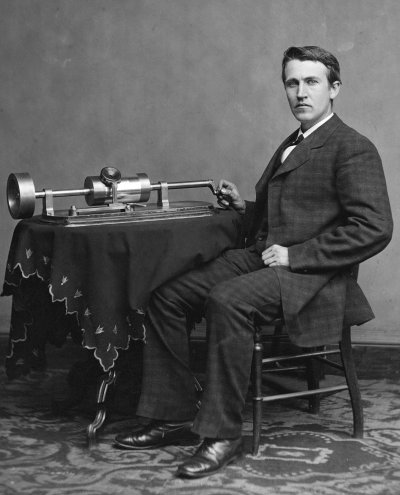 Edison with his early phonograph, 1878.